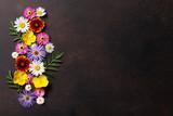 Garden flowers on stone - 163174286