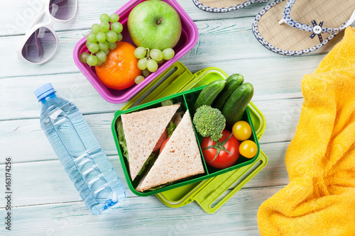 Vacation lunch box and items © karandaev