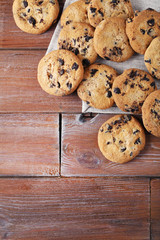 Chocolate chip cookies with napkin on brown wooden table