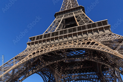close up of Eiffel tower against blue sky