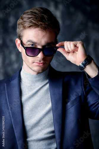 formal man in sunglasses