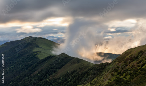 Clouds forms in the mountains at sunrise