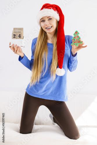 Christmas woman holding calendar and tree