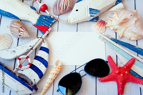 Summer holiday background. Sea card with ship, sand, shells and starfish on white background top view. Vacation season. Copy space