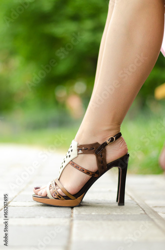 Woman legs in high heel shoes.