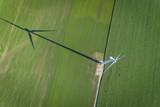Wind turbine in a green field, top aerial view - 163208421
