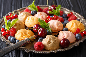Colorful shortbread cookie with fresh summer berries close-up on the plate. Horizontal