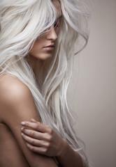 Pretty nude lady with a lush coiffure © konradbak