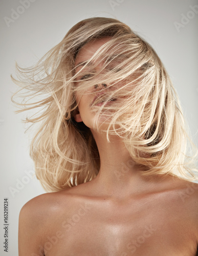 Fashion style portrait of a blonde with tangled hair