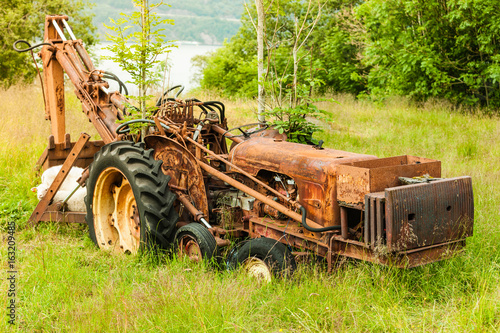 Old agricultural machinery covered with rust
