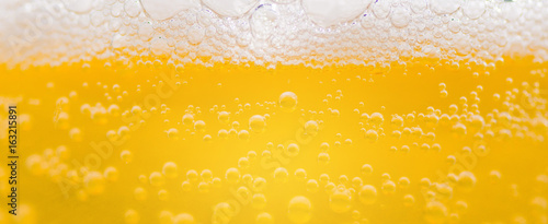 bubble beer close up / yellow background / water / drink - 163215891