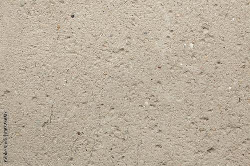 Rough unpainted concrete wall.