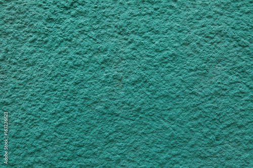 Emerald green painted stucco wall.