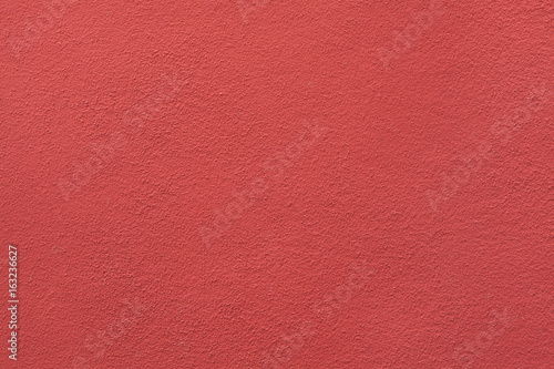 Red painted stucco wall.