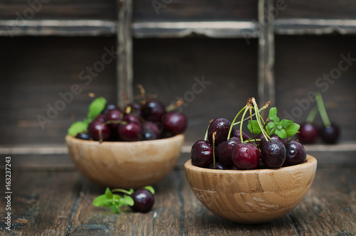 Fresh weet cherry and green mint on the wooden table