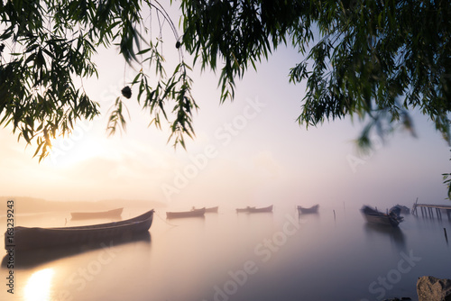 Boats in the morning fog