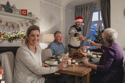 Happy Mother At Christmas Dinner Poster