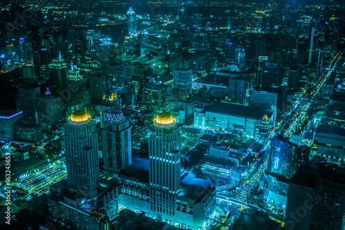 Lighting modern business buildings, transport - top view of Bangkok at dusk from Baiyoke Sky Hotel