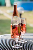 Wine glasses on table at garden in a sunny day - 163251693