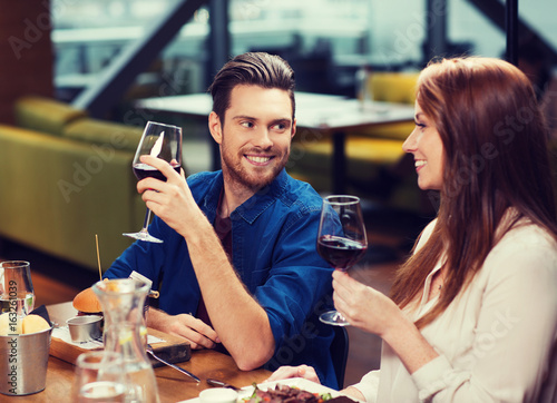 couple dining and drinking wine at restaurant