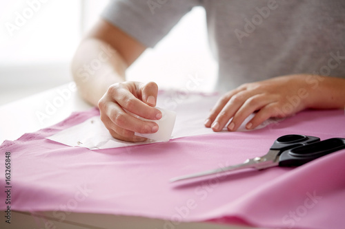 woman with pattern and chalk drawing on fabric