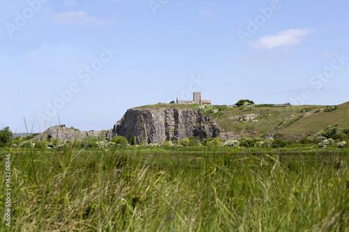 View across fields to St Nicholas church, Uphill near Weston Super Mare, Somerset, UK