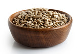 Peeled dry sunflower seeds in dark wooden bowl isolated on white. - 163267660