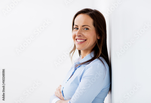 Plakát happy smiling middle aged woman at office