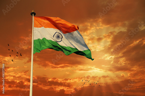 Foto Murales Tricolor Indian Flag during Sunset and beautiful sky