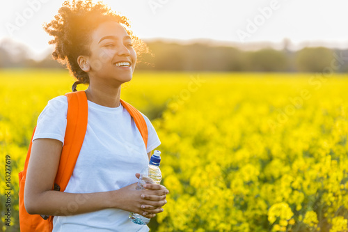 Mixed Race African American Girl Teenager In Yellow Flowers at Sunset