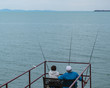 Old couple sitting and fishing together