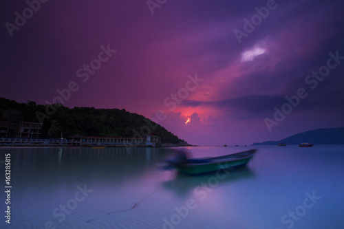 Foto op Canvas Aubergine scenery of sunrise at perhentian island.soft focus,motion blur due to long exposure