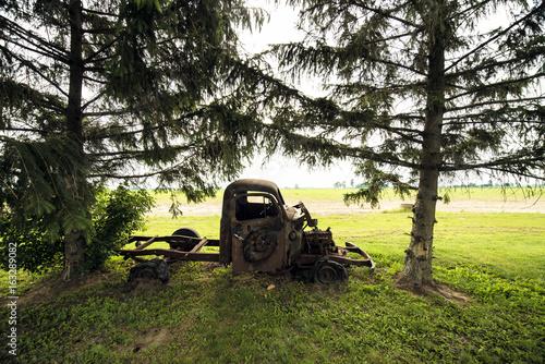 old rusty beatup retro truck in field
