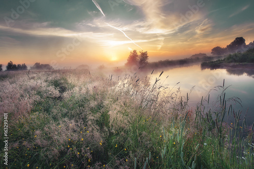 Beautiful landscape of morning sunrise over river in nature colorful autumn