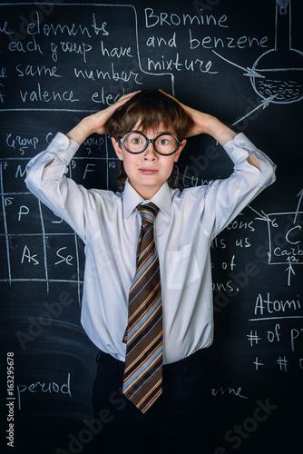 puzzled school boy