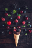 Fresh berries fruits and ice cream cone - 163297233