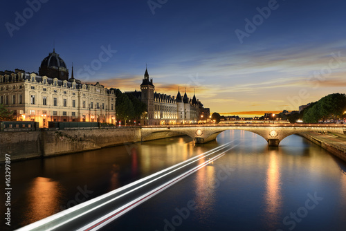 Boat tour on Seine river in Paris with sunset. Paris, France Poster