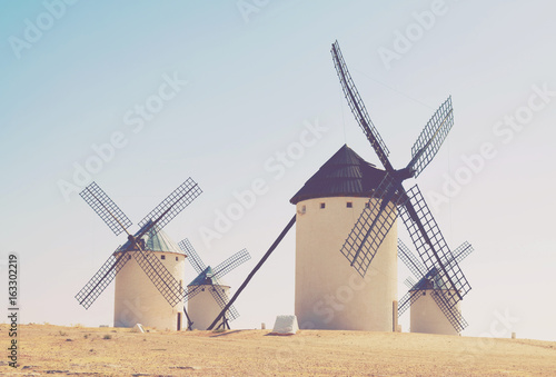Group of retro windmills - 163302219