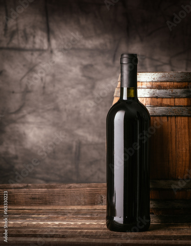 Red wine bottle in the cellar - 163330223