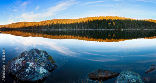 Lake in a forest in autumn in Lapland