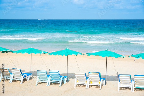 Row of beach chairs lined up on the beach in Phuket,Thailand. Poster