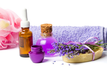 Lavender oil and purple wellness set with flowers
