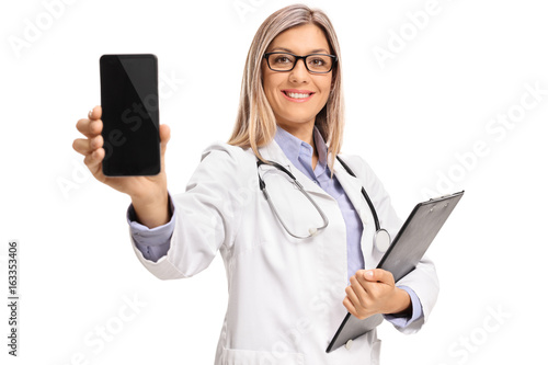 Female doctor with a clipboard showing a phone