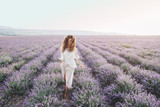 Boho styled model in lavender field - 163356245
