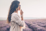 Boho styled model in lavender field - 163356246
