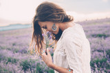 Boho styled model in lavender field - 163356251