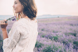 Boho styled model in lavender field - 163356253