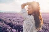 Fototapety Boho styled model in lavender field