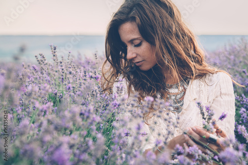 Boho styled model in lavender field - 163356261