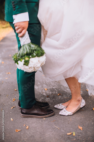 Leg and shoes of wedding couple outdoor
